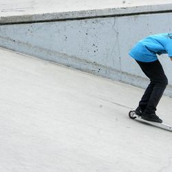 Chase Neill, a seventh-grader at Granite Park Junoir High, rides his scooter at Fairmont Skate Park in Salt Lake City on Wednesday, Nov. 21, 2012. Utah lawmakers are pushing to add more physical activity in schools because being active increases brain function, according to a nationwide study called SPARK.