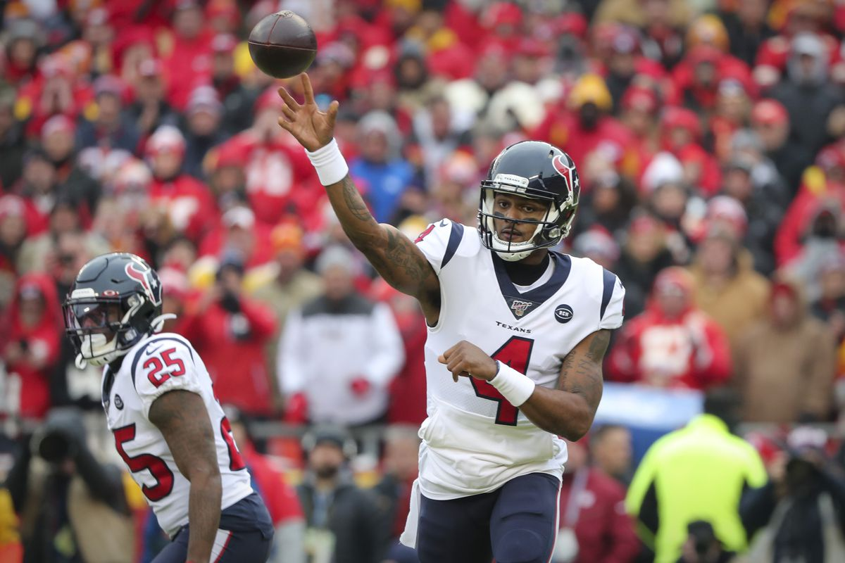 Houston Texans quarterback Deshaun Watson passes against the Kansas City Chiefs during the first quarter in a AFC Divisional Round playoff football game at Arrowhead Stadium.
