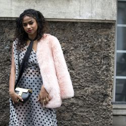 Vashtie Kola in pink fur and a Chloé handbag.