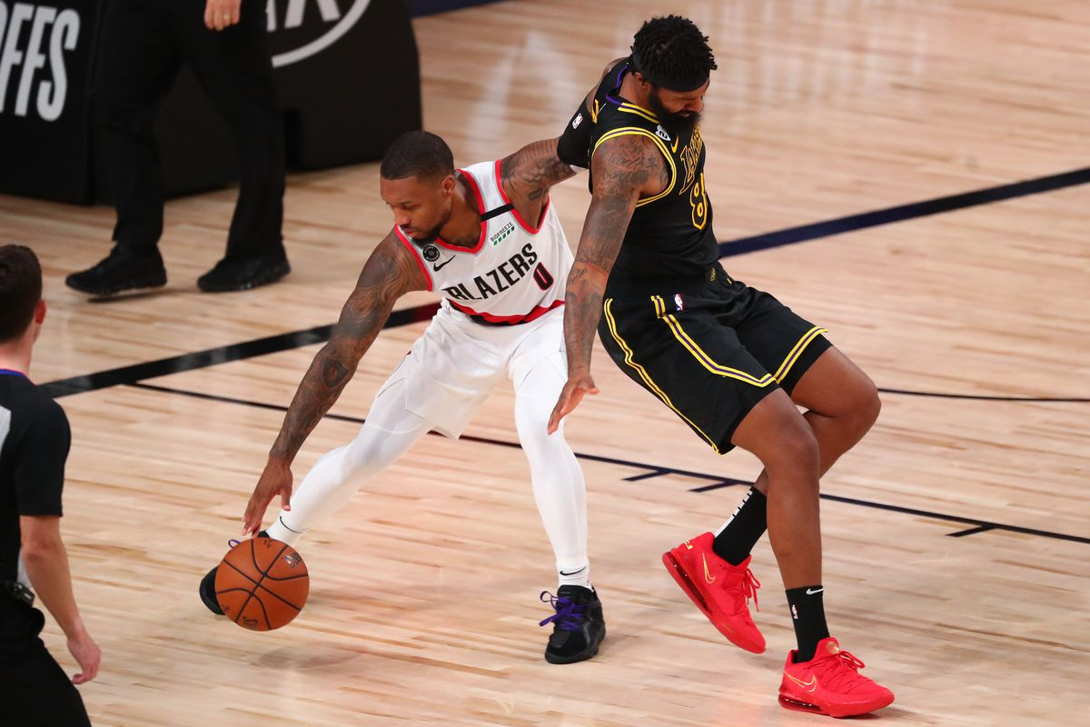 Portland Trail Blazers guard Damian Lillard steals the ball from Los Angeles Lakers forward Markieff Morris in the second half in game four of the first round of the 2020 NBA Playoffs at AdventHealth Arena.