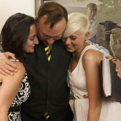 State Sen. Jim Dabakis hugs Yolanda Pascua, left, and Laekin Rogers, right, after performing their marriage at the Salt Lake County Clerk's Office in Salt Lake City, Monday, Oct. 6, 2014.