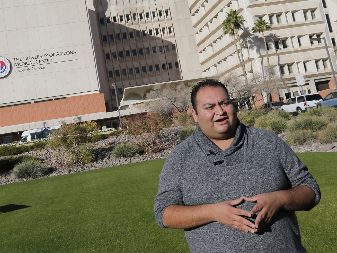 In this Jan. 8, 2014, file photo, Daniel Hernandez Jr., a former intern for U.S Rep. Gabrielle Giffords, speaks prior to a remembrance ceremony on the third anniversary of the Tucson shootings, in Tucson, Ariz.