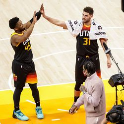 Utah Jazz guard Donovan Mitchell (45) and forward Georges Niang (31) celebrate their win over the Oklahoma City Thunder at Vivint Smart Home Arena in Salt Lake City on Tuesday, April 13, 2021.
