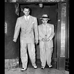 """Leaving the Continental Cafe on Santa Monica Boulevard in 1949. Mickey was shot an hour later. Photo via the <a href=""""http://framework.latimes.com/2013/01/04/mickey-cohen-wounded/#/0"""">LAT</a>."""
