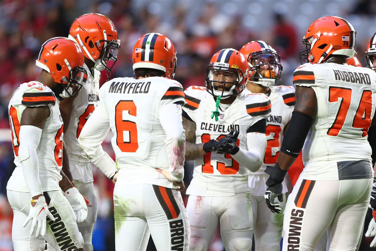 Cleveland Browns wide receiver Odell Beckham Jr.  in the huddle with quarterback Baker Mayfield against the Arizona Cardinals at State Farm Stadium.