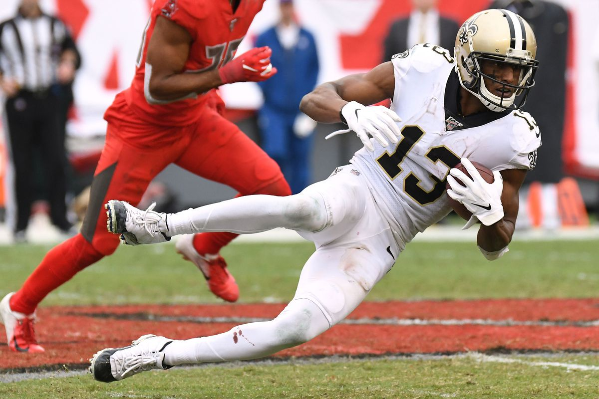 New Orleans Saints wide receiver Michael Thomas is tackled by the Tampa Bay Buccaneers in the second half at Raymond James Stadium.