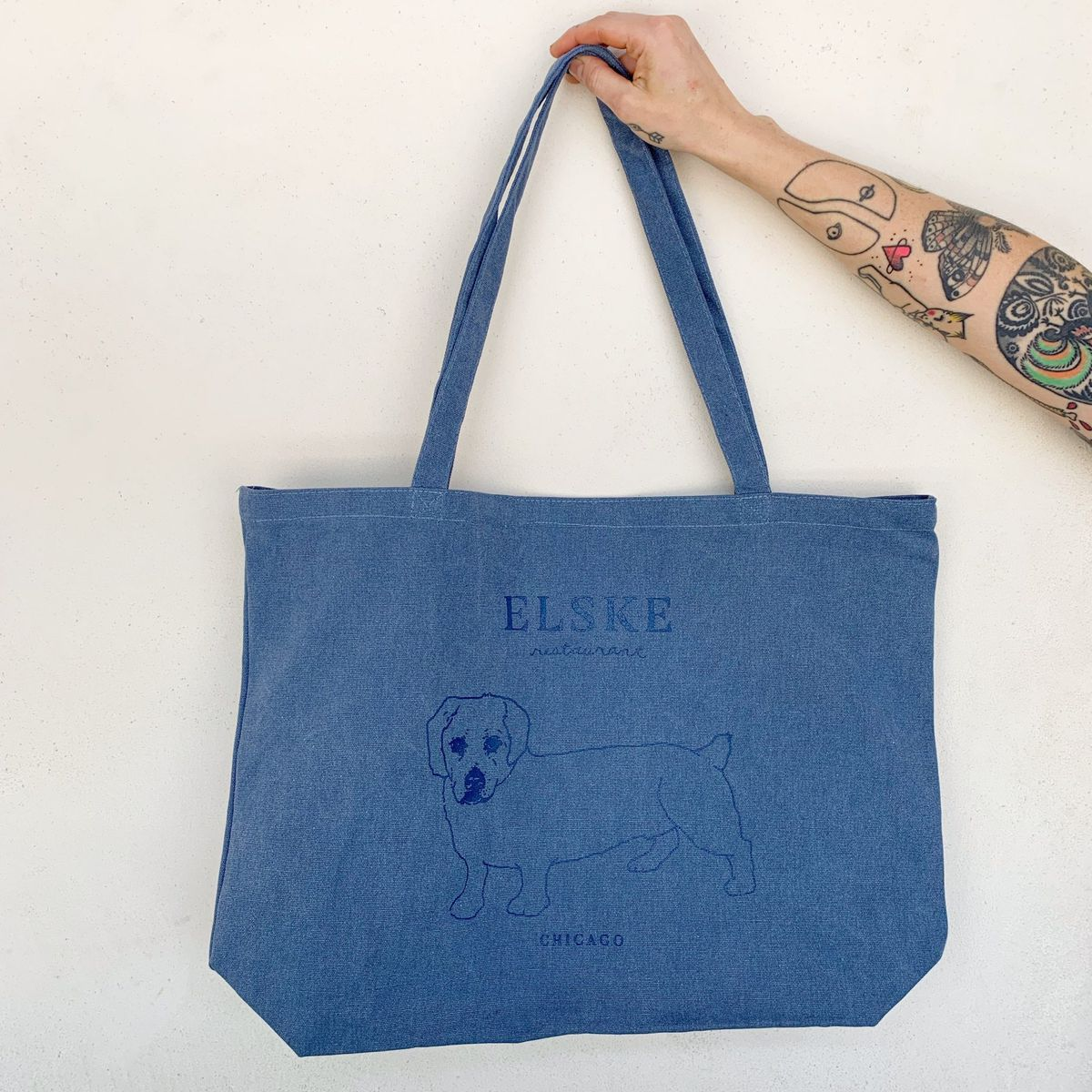 A blue bag with a dog printed on it.