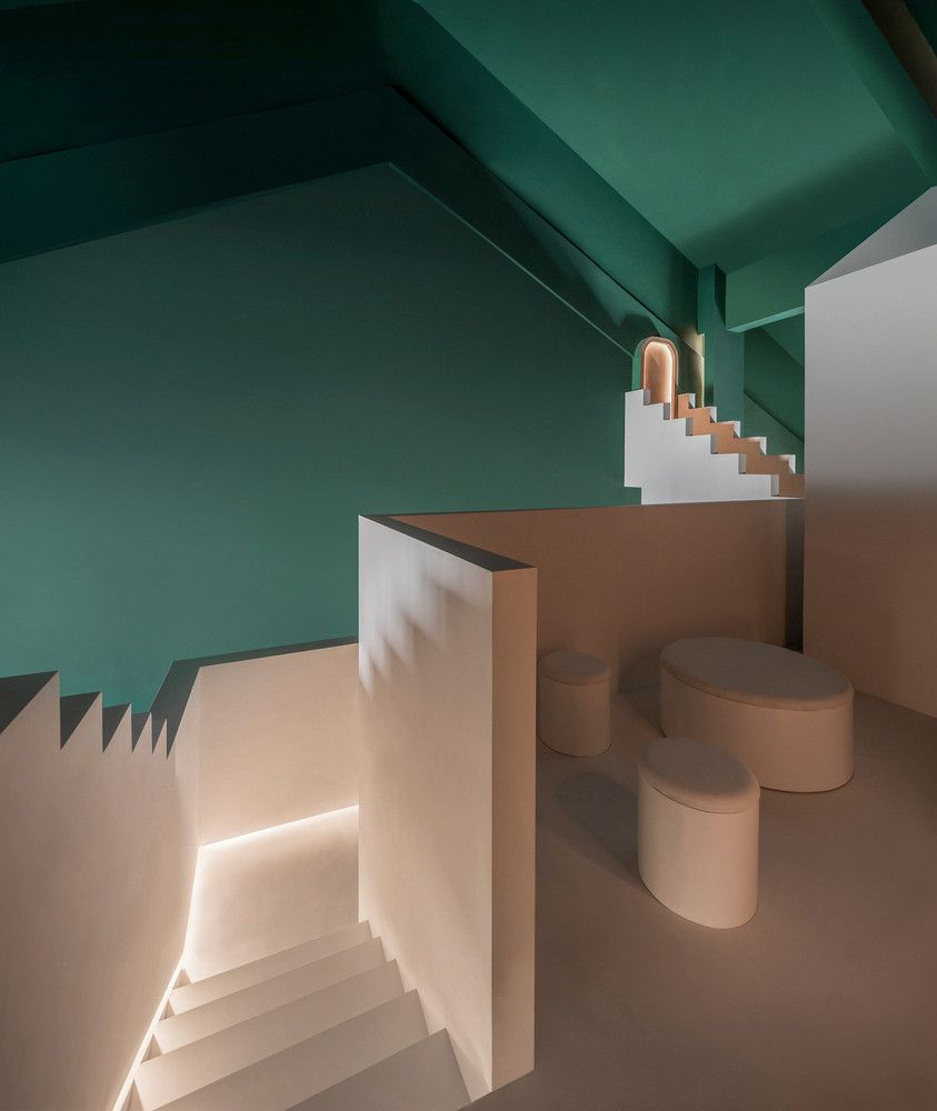 Room with green walls and a series of white stairs