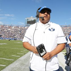 Brigham Young Cougars head coach Kalani Sitake watches his team come onto the field  in Provo on Saturday, Nov. 12, 2016.
