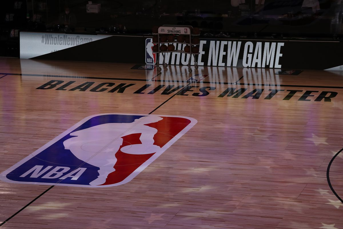 A general view the court with Black Lives Matter written above the NBA logo is seen at center court prior to the game between the LA Clippers and the Los Angeles Lakers at The Arena at ESPN Wide World Of Sports Complex on July 30, 2020 in Lake Buena Vista, Florida.