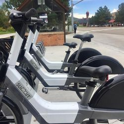 A smartphone app unlocks a Summit Bike Share electric bike.