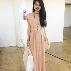 Photographer Kristine Lo looked lady-like with an edge in a plunging pastel pink dress.