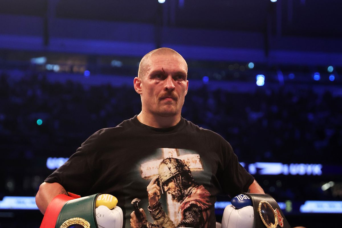Oleksandr Usyk celebrates after being crowned the new World Champion following the Heavyweight Title Fight between Anthony Joshua and Oleksandr Usyk at Tottenham Hotspur Stadium on September 25, 2021 in London, England.