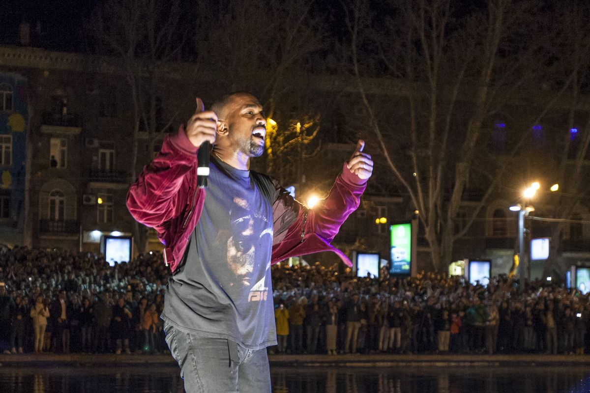 Kanye West performs an impromptu gig near Swan Lake in Yerevan, Armenia, Sunday, April 12, 2015. The Kardashian sisters, along with Kim's husband Kanye West and their daughter North are on a visit to their ancestral Armenia. The concert was halted by police after the singer jumped into a lake, prompting hundreds of fans to jump in after him. (AP Photo/PAN Photo / Vahan Stepanyan) ORG XMIT: MOSB104