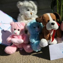 A small memorial to the victims of Tuesday's fatal shooting is seen on the sidewalk on Alta Canyon Drive in Sandy on Wednesday, June 7, 2017.