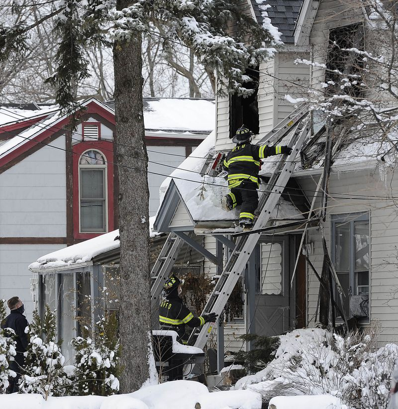 Des Plaines firefighters climb ladders to investigate the house were fire and smoke claimed the lives of four children and one adult in 700 block of Oakton St. in Des Plaines.