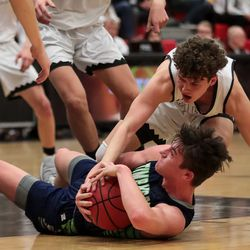 Timpanogos' Conner Snowden and Alta's Hunter Humpherys rush for a loose ball in a boys basketball game at Alta High School in Sandy on Tuesday, Jan. 21, 2020.