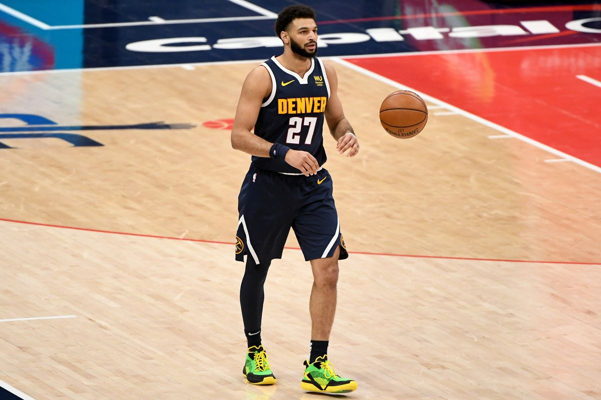 Jamal Murray of the Denver Nuggets dribbles against the Washington Wizards during the first half at Capital One Arena on February 17, 2021 in Washington, DC.