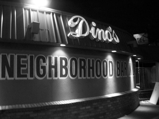 A black and white photo of a neighborhood dive bar