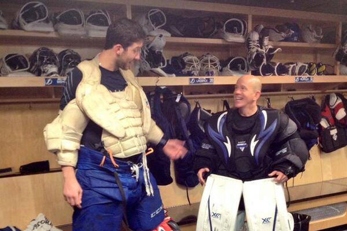 Darren Pang and Ben Bishop swap goalie gear.