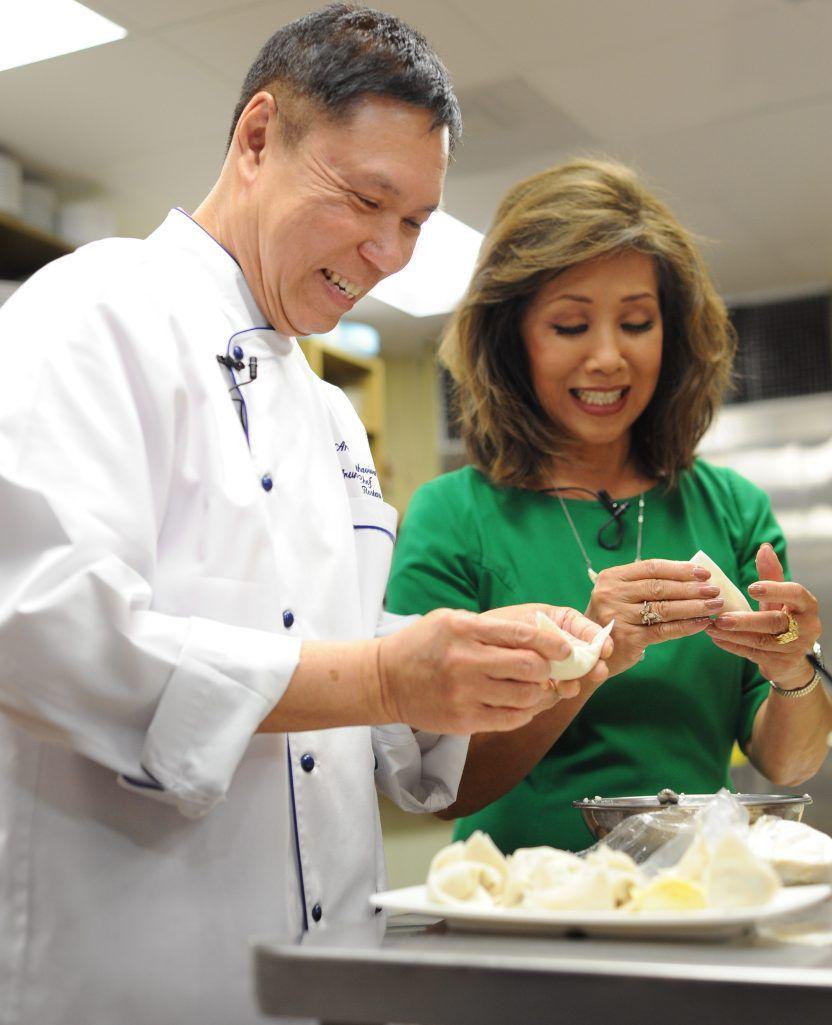 Wrapping pureed calamari in wonton skins to make dumplings.   Victor Hilitski/For the Sun-Times