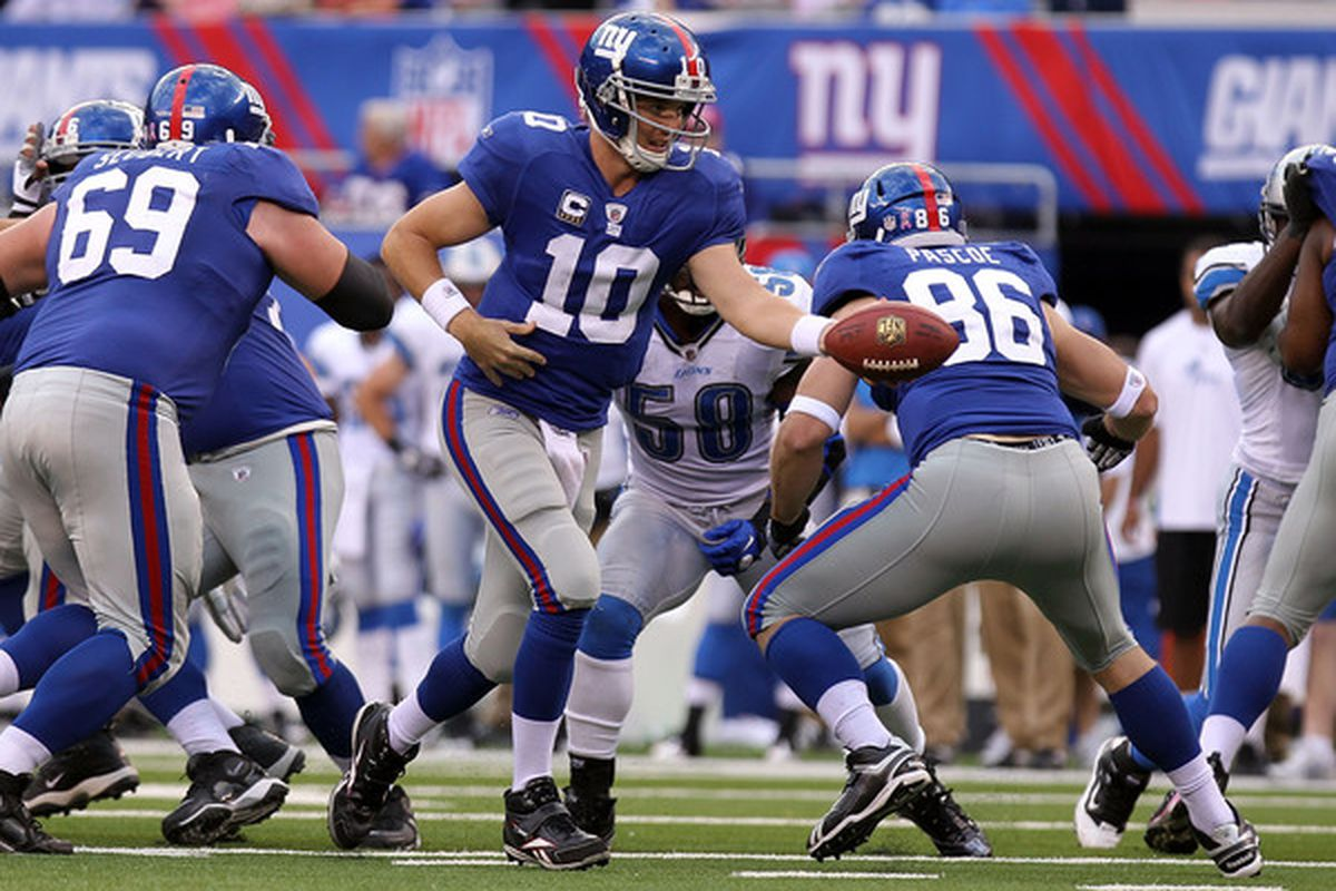 Eli Manning (10) of the New York Giants passes against the Detroit Lions at New Meadowlands Stadium on October 17 2010 in East Rutherford New Jersey.  (Photo by Nick Laham/Getty Images)