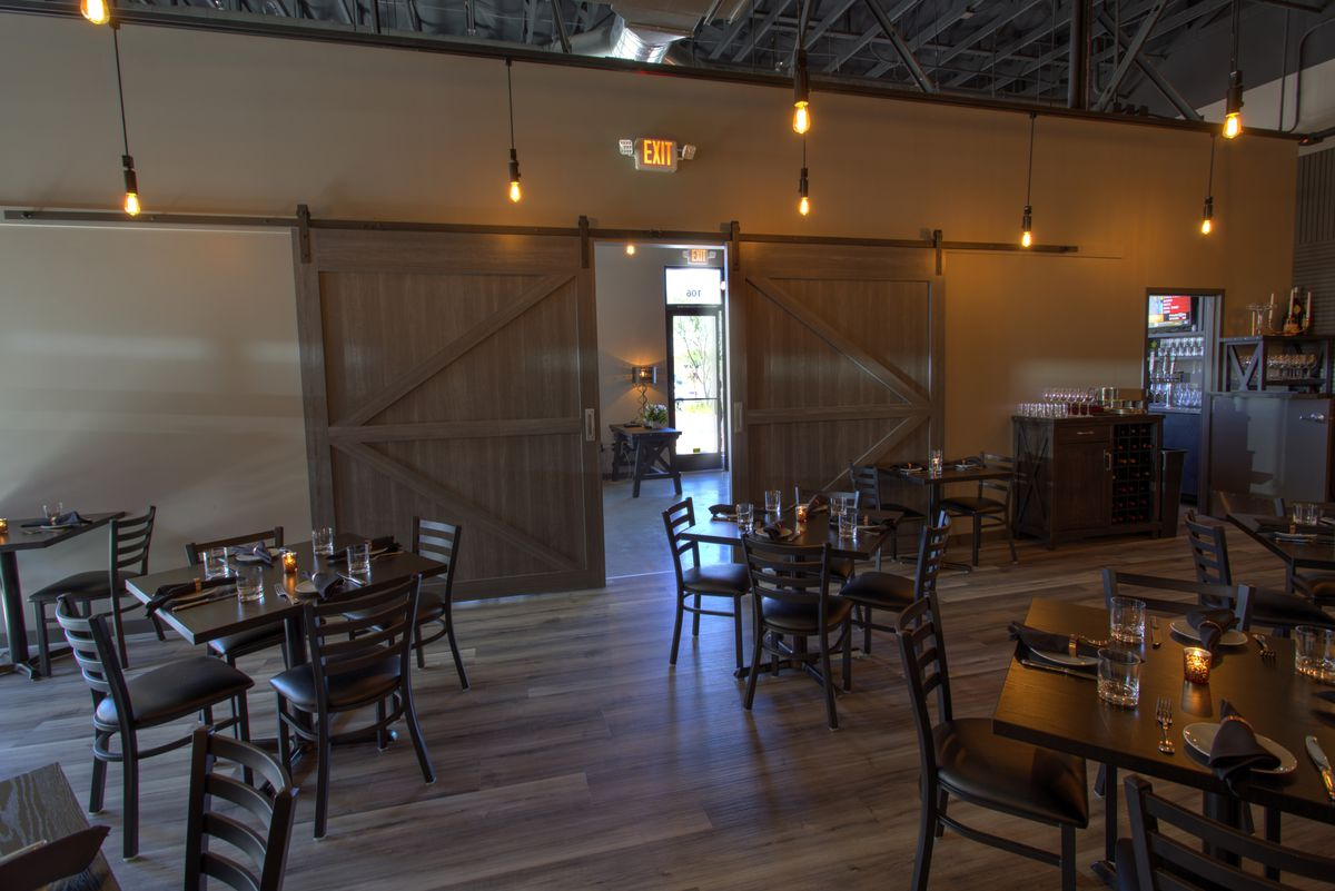 Sliding barn doors separate the dining room from the patio at Locale Italian Kitchen.