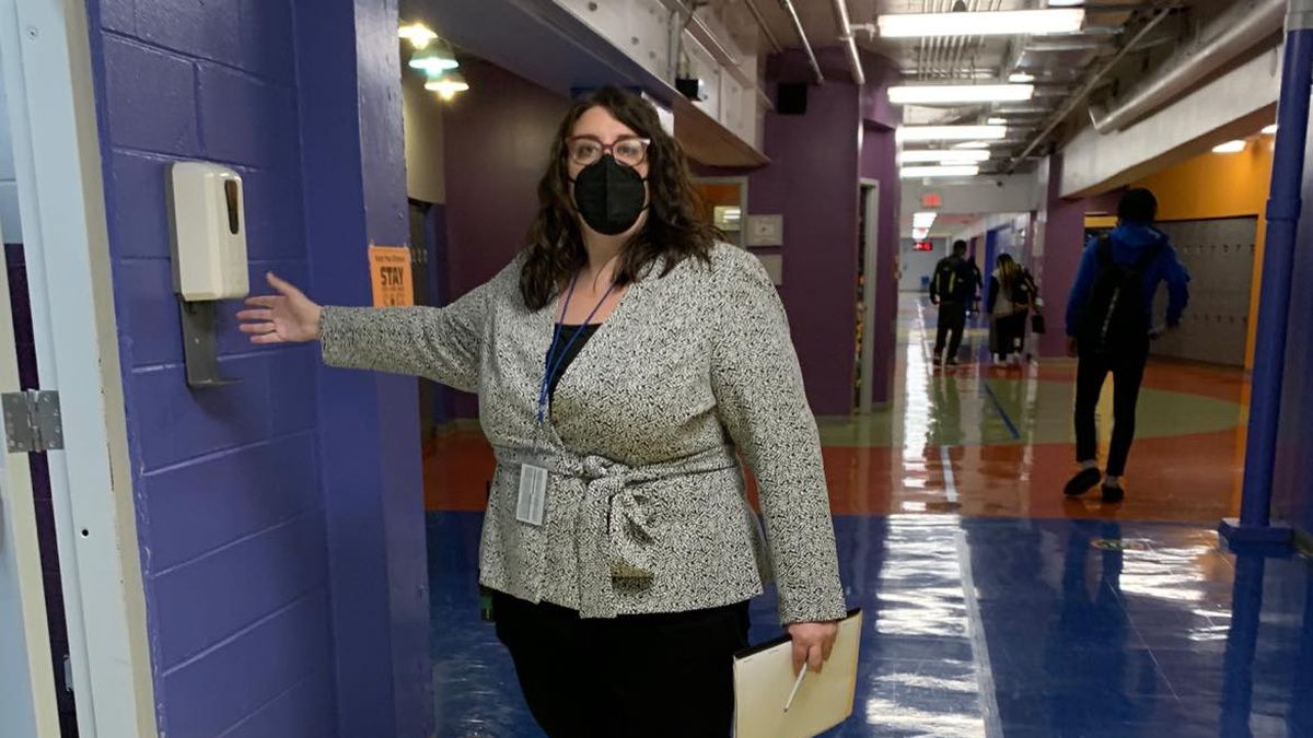 Margaux Munnelly, principal Mastery Charter School-Pickett Campus in Germantown, uses the hand sanitizer station in the hallway.