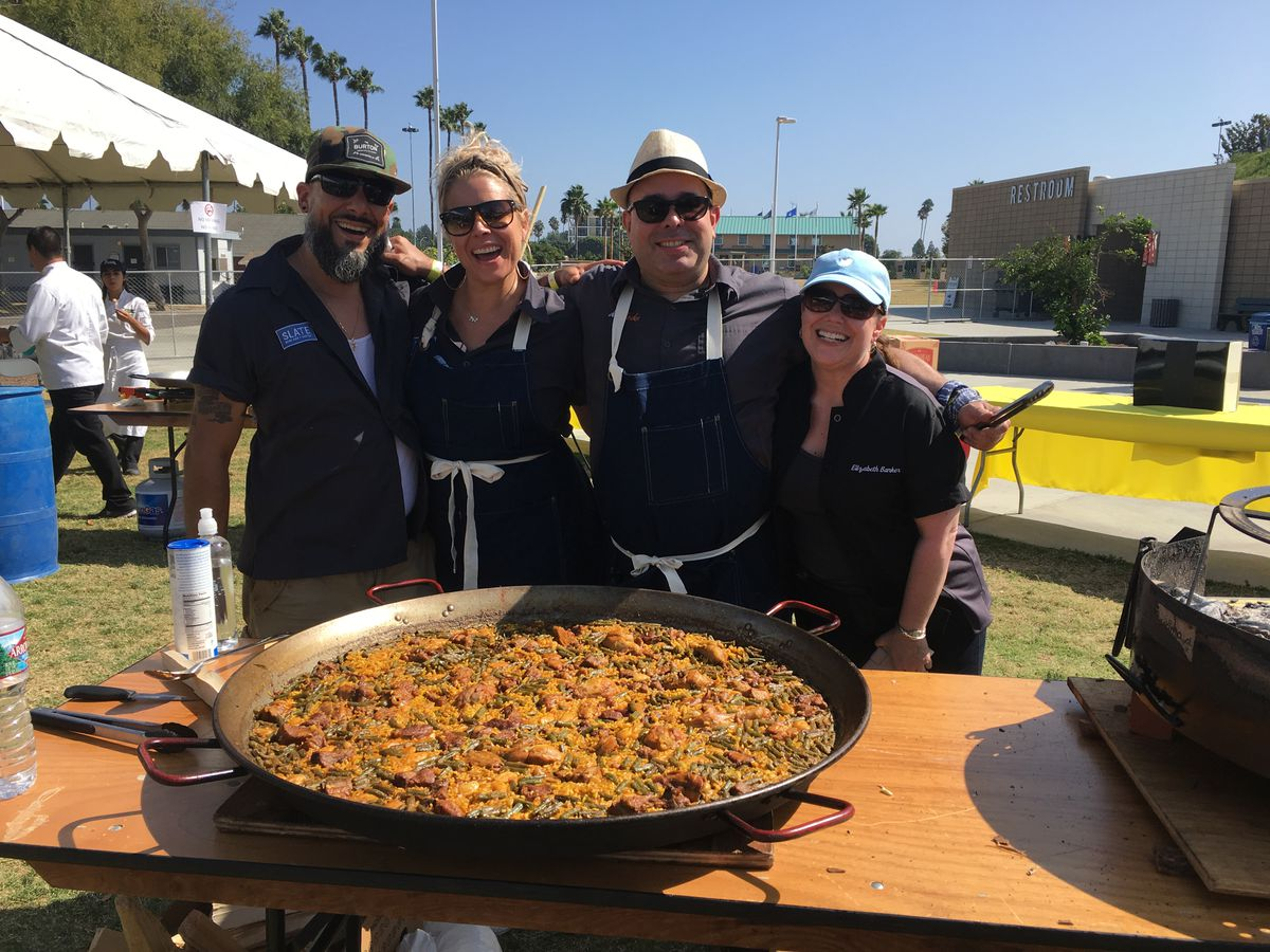 Danny Lledó, second from right, and friends at a paella competition.