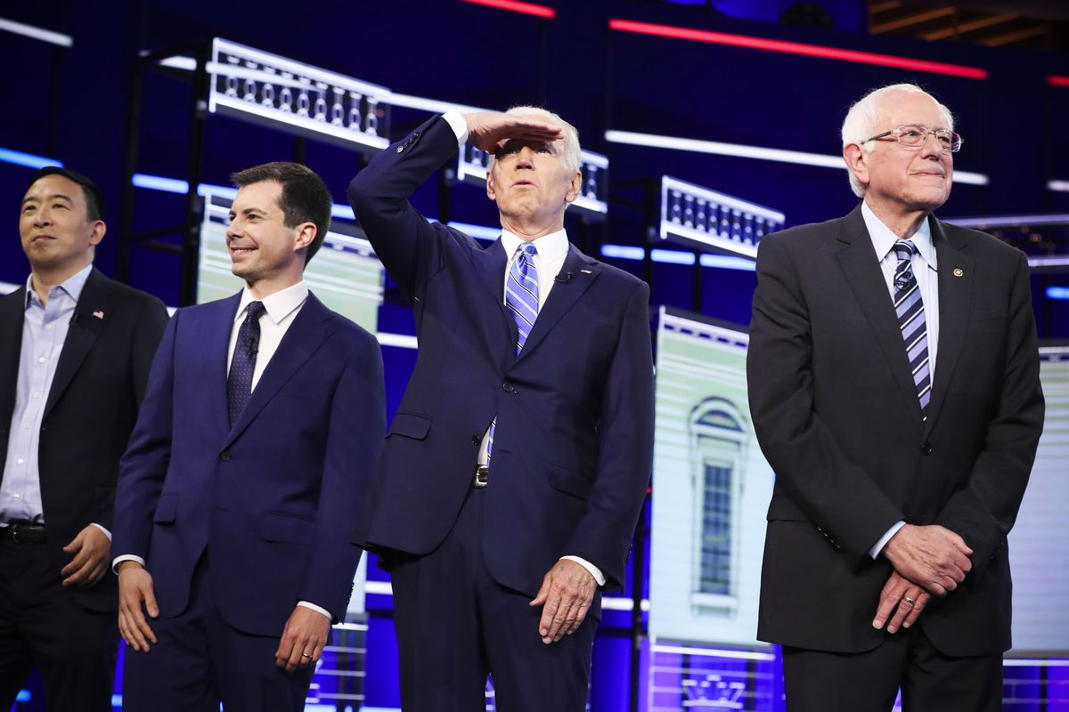 Former Vice President Joe Biden (2nd-R), Sen. Bernie Sanders (I-VT) (R), South Bend, Indiana Mayor Pete Buttigieg (2nd L), and former tech executive Andrew Yang walk on stage during the second night of the first Democratic presidential debate on June 27,