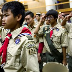 FILE - Sha Kler of Troop 1262 stands at attention while the colors  were presented during a Court of Honor ceremony at the Camp Tracy Lodge in Salt Lake City on Wednesday, Sept. 28, 2016.