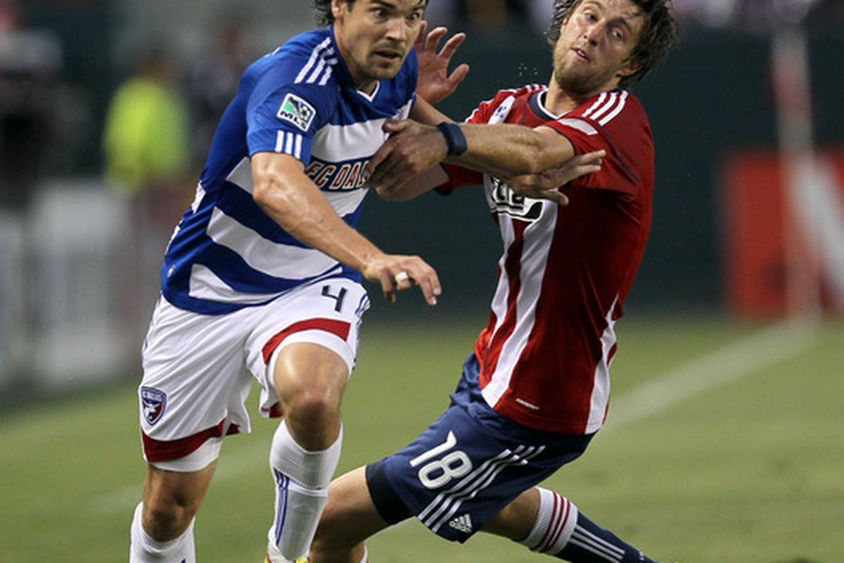 CARSON, CA - JUNE 26: Heath Pearce #4 of FC Dallas wins the ball from Blair Gavin #18 of Chivas USA on June 26, 2010 at the Home Depot Center in Carson, California. (Photo by Stephen Dunn/Getty Images)
