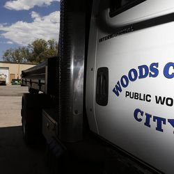 A truck with the city logo is parked at right with Woods Cross Public Works buildings in the background on Tuesday, Aug. 9, 2016.