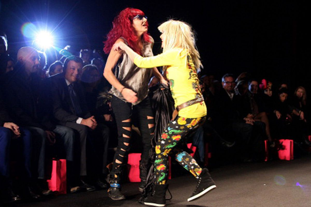 Betsey Johnson, who showed her collection yesterday, hugs stylist Pat Field. Via Getty