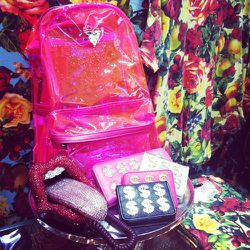 Spring accessories include see-through fluorescent backpacks.