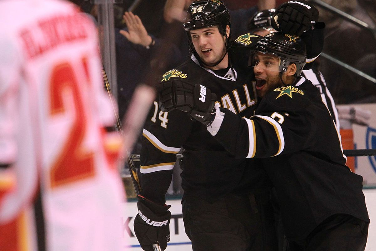 DALLAS, TX - MARCH 24:  Jamie Benn #14 of the Dallas Stars celebrates his goal with Trevor Daley #6 during play against the Calgary Flames at American Airlines Center on March 24, 2012 in Dallas, Texas.  (Photo by Ronald Martinez/Getty Images)