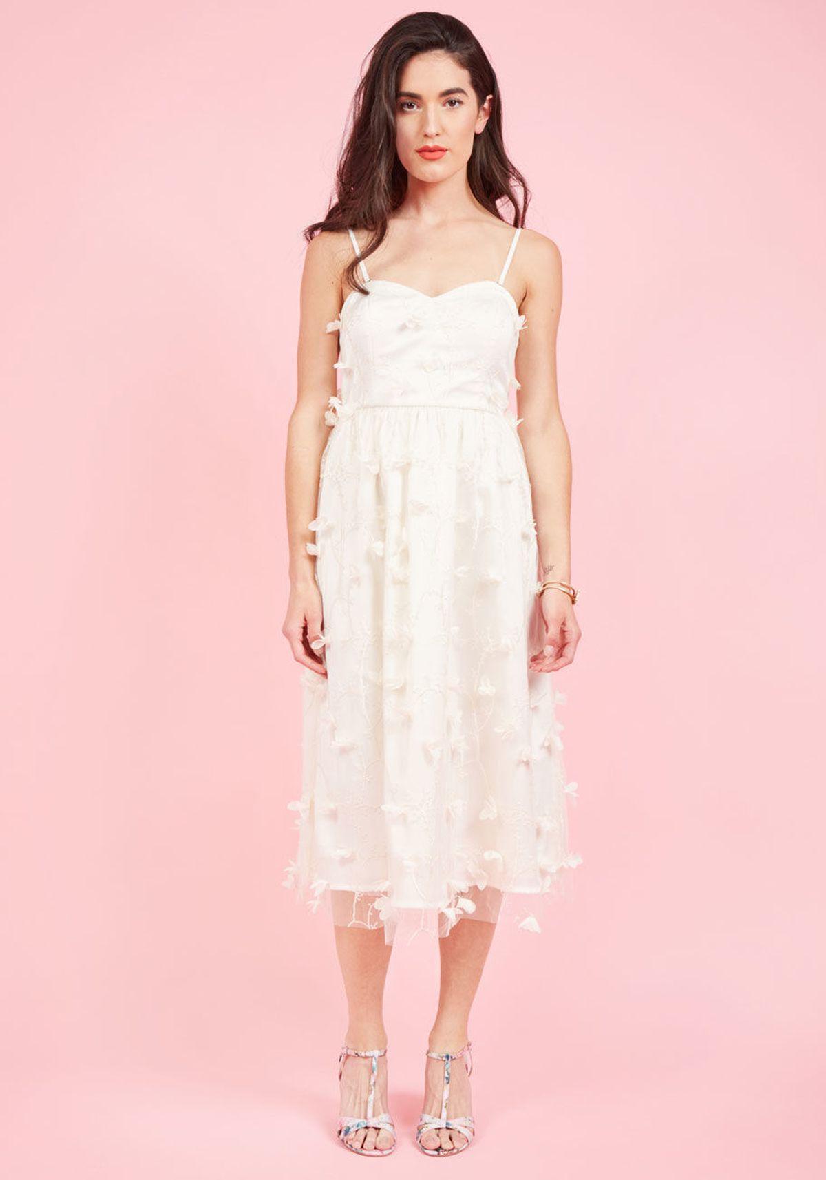 Model In Wedding Dress On Pink Background