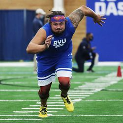 Offensive lineman Tristen Hoge participates in the 20-yard shuttle during BYU pro day in Provo on Friday, March 26, 2021.