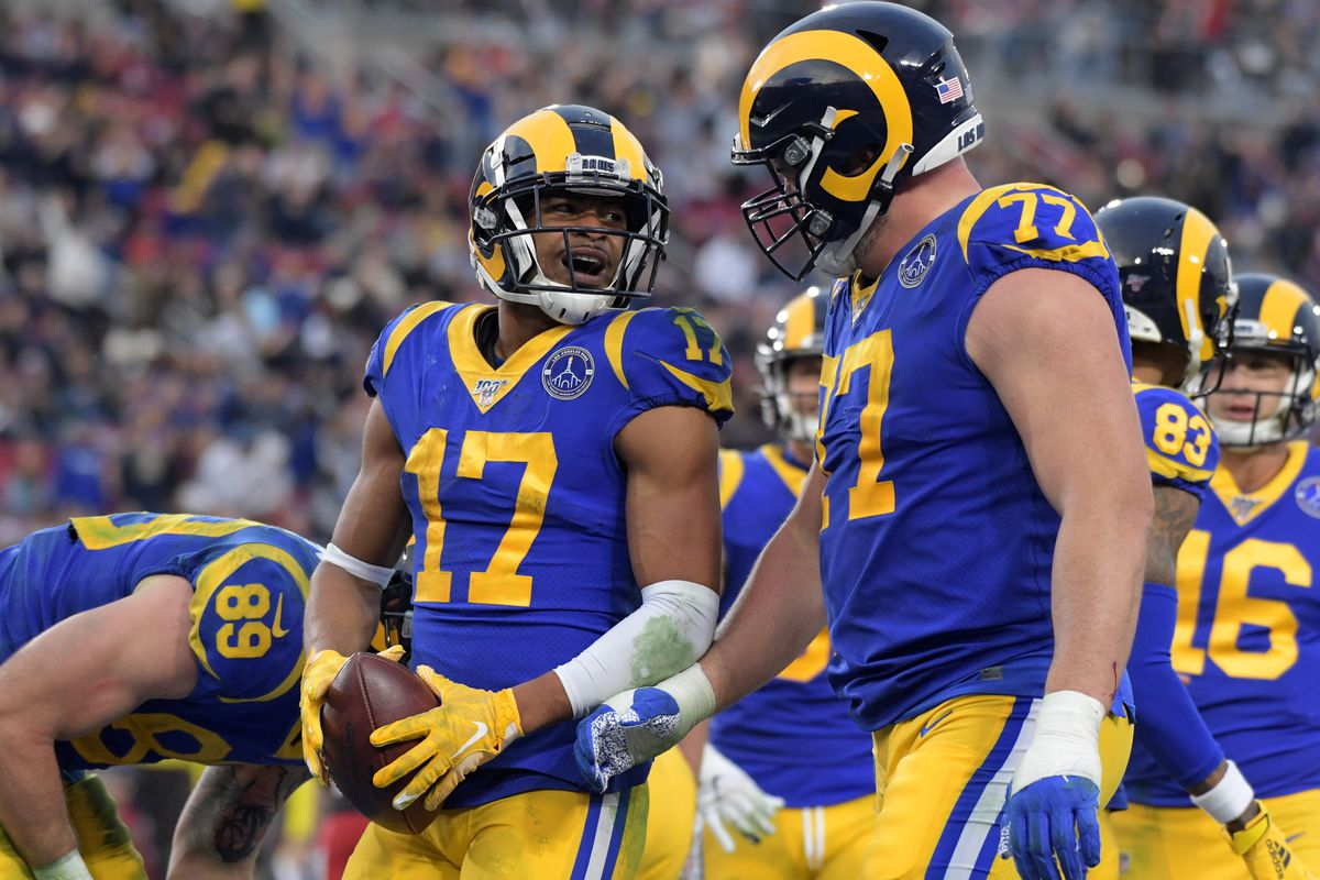 Los Angeles Rams wide receiver Robert Woods celebrates with offensive tackle Andrew Whitworth  after scoring on an 11-yard touchdown pass against the Arizona Cardinals in the fourth quarter of the final Rams home game at Los Angeles Memorial Coliseum before moving to SoFi Stadium for the 2020 season.