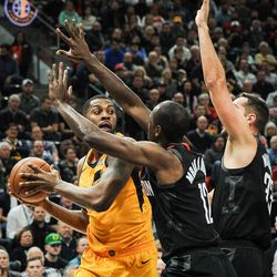 Utah Jazz forward Derrick Favors (15) looks to pass after being double-teamed by Houston Rockets forward Luc Mbah a Moute (12) and Houston Rockets forward Ryan Anderson (33) as the Utah Jazz host the Houston Rockets at Vivint Smart Home Arena in Salt Lake City on Thursday, Dec. 7, 2017.
