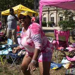 A parade goer dances and cheers while watching the Bud Billiken Parade Saturday.