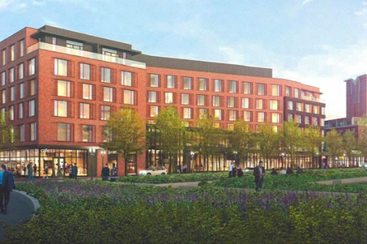 Rendering of a six-story hotel off a public park.