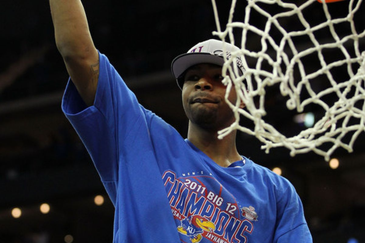 KANSAS CITY, MO - MARCH 12:  Marcus Morris #22 of the Kansas Jayhawks will be cutting more nets down at the end of this month...