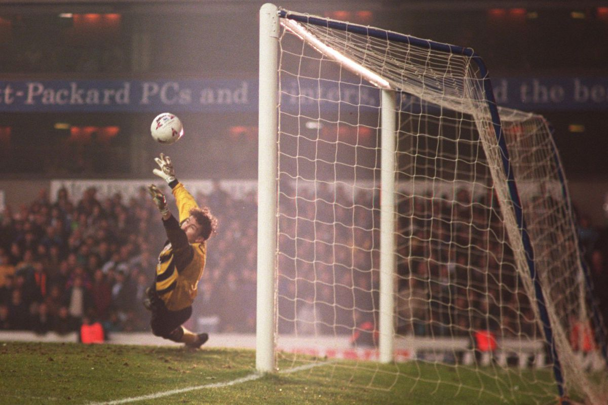 9 MAR 1996: Mark Crossley of Forest saves Teddy Sheringham of Spurs penalty to put Forest through during Tottenham Hotspurs v Nottingham Forest in the FA cup Fifth round replay at White Heart Lane.