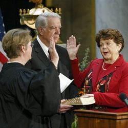 Olene Walker becomes the first woman governor of Utah in Salt Lake City on Nov. 5, 2003. She is sworn in by Chief Justice Christine Durham.