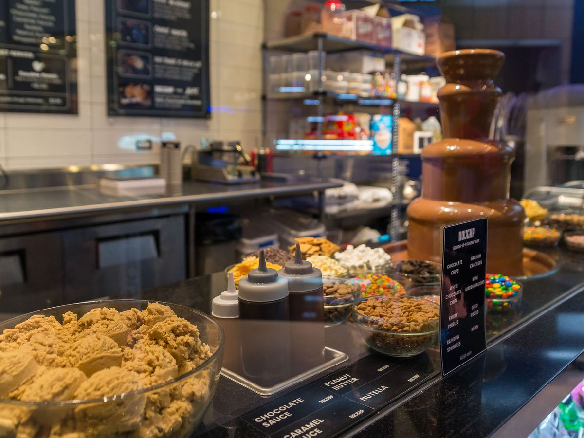 Counter at restaurant displaying cookie dough