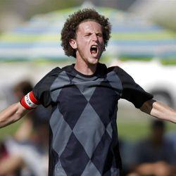 Weber's #8 Zach Barker celebrates their win over as Davis Tuesday, April 24, 2012. Weber won 5-0.