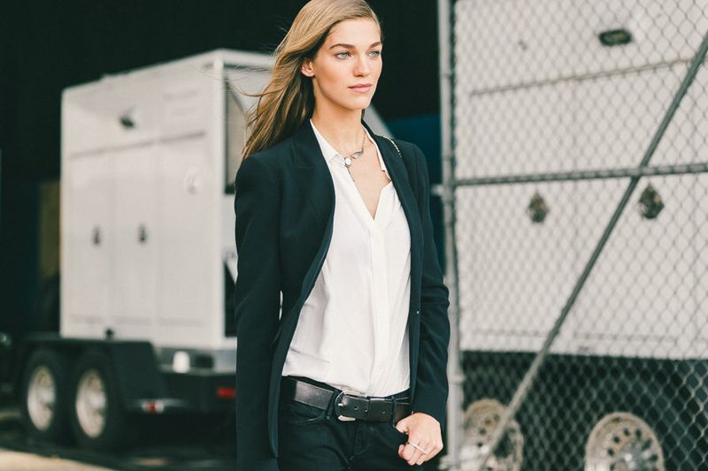 A woman in a white shirt and black jacket.