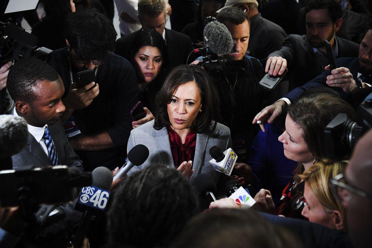 Senator Kamala Harris surrounded by reporters.