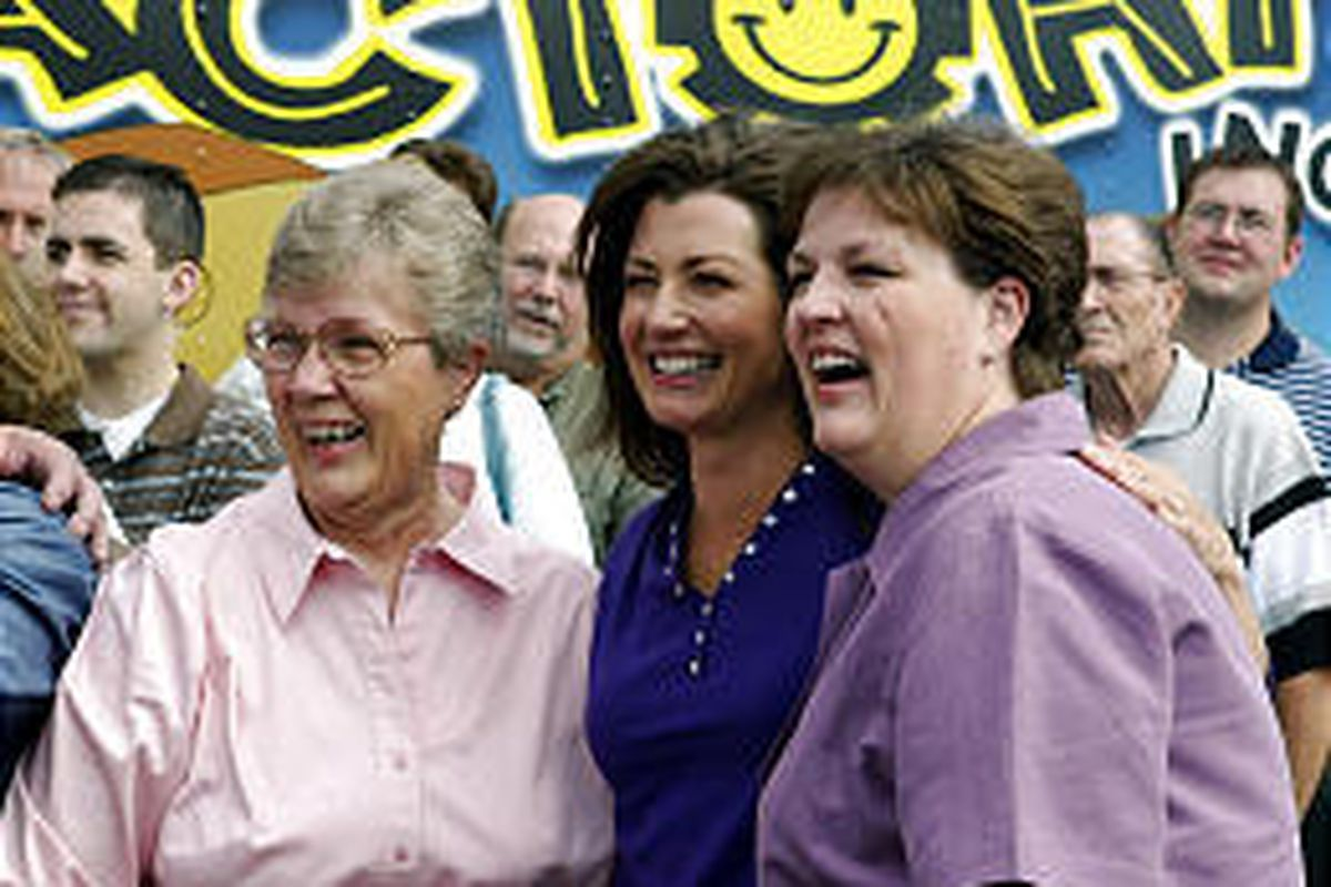 """""""Three Wishes"""" host Amy Grant, center, with the folks in Cedar City."""